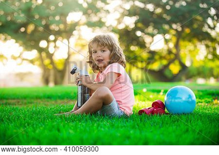 Healthy Kids Lifestyle. Sporty Kid. Boy Drinking Water. Sport Concept. Child Fitness, Health And Ene