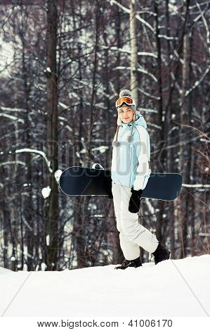 Young Woman With Snowboard On Ski Slope