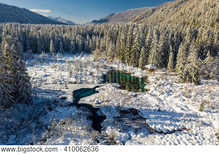 Aerial View Of Nature Reserve Zelenci In Kranjska Gora, Slovenia. Green Lake With Idylic Snowy Winte
