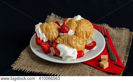Mouthwatering Eclairs With Ice Cream, Whipped Cream And Fresh Strawberries, The Perfect Dessert, Bea