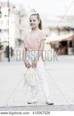 Kid Long Hair Enjoy Walk Sunny Day. Summer Holidays. Charming Stylish Fashionable Girl. Little Child