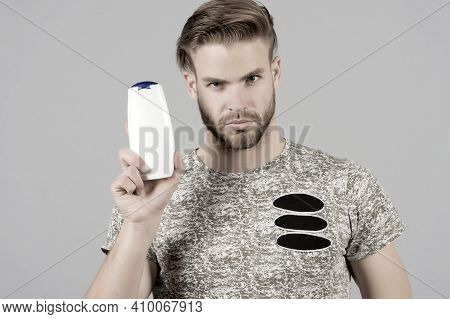 Man Enjoy Freshness After Washing Hair With Shampoo. Guy With Hairstyle Holds Bottle Shampoo, Copy S