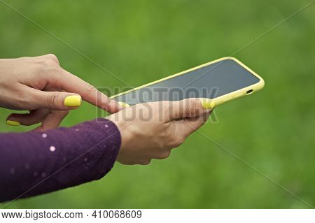 Using Mobile App. Mobile Phone In Female Hands. Smartphone With Touchscreen. Mobile Device. New Tech