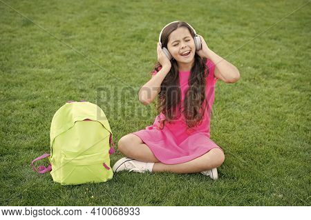 Girl Headphones Listening Music. Pleasant Time. Child Headphones Listen Music. Modern Technology. Sc