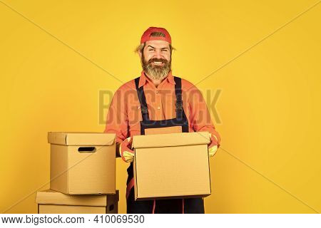 Confident Worker. Express Delivery Concept. Man Worker In Boilersuit At Box. Moving To New Apartment