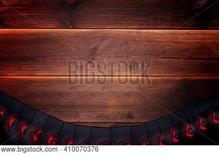 Minsk, Belarus, December 27, 2019. Fortune-telling Cards On A Wooden Table With Place For Text. Divi