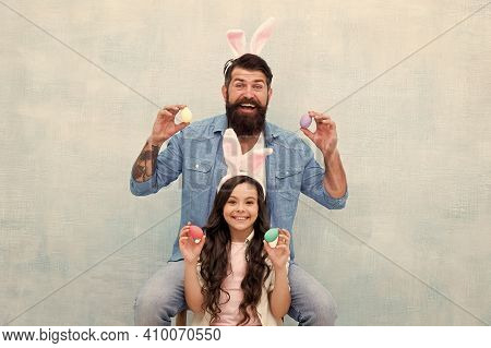 Happy Father And Daughter Celebrate Easter. Happy Easter Holiday. Small Girl Wear Funny Bunny Ears W