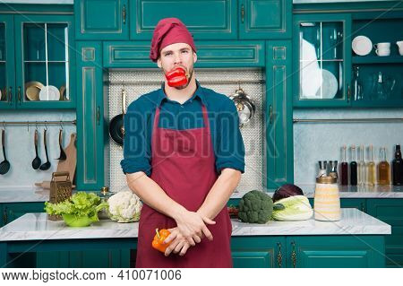 Man Chef Wear Apron Cooking In Kitchen. Man Cook Vegetarian Recipe Pepper Vegetables. Vegetarian Die