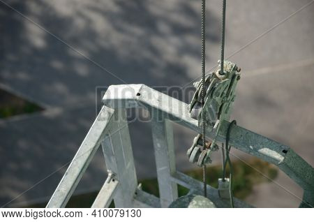 Safety Lock As Part Of Suspended Wire Rope Platform For Facade Works On High Multistorey Buildings.