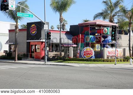 Santa Ana, California - USA - February 25, 2021: Burger King Fast Food Restaurant with children's play ground outside. Fast Food is enjoyed by hungry people world wide on a daily basis. Editorial Use.
