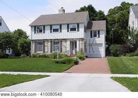 Traditional two story style mid century suburban home, main focus on upper story windows
