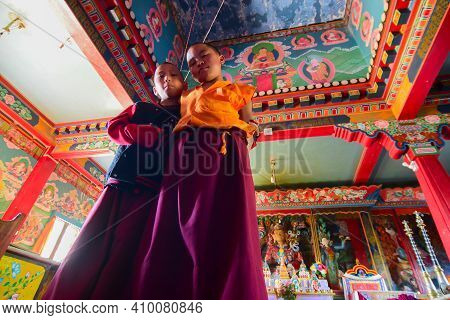 Rinchenpong, Sikkim, India - 17th October 2016 : Two Young Boy Lamas Watching Photographer Inside Pr