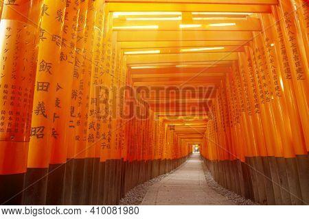 Red Wooden Tori Gate At Fushimi Inari Shrine In Kyoto, Japan