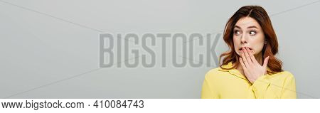 Discouraged Woman Covering Mouth With Hand While Looking Away Isolated On Grey, Banner.