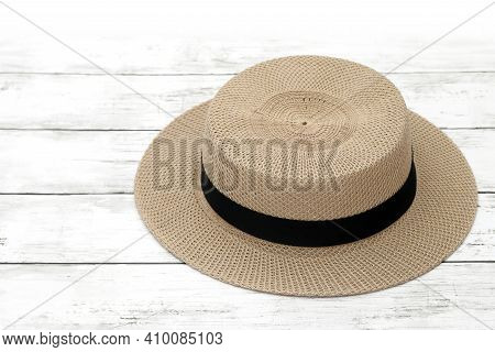 Lady Straw Hat On White Wooden Table