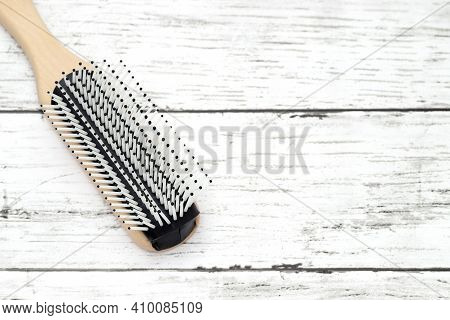 Wooden Hairbrush On White Table, Close Up