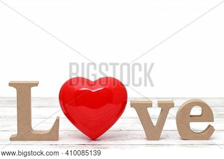 Red Heart Decoration On An Aged White Wooden Table