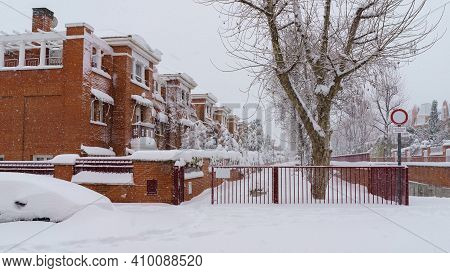 Streets And Buildings Covered In Snow By Day Due To Snowstorm Filomena Falling In Madrid Spain. Euro