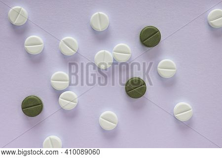 Purple Tinted Background On The Theme Of Medicine, Health Care, Drugs, Pharmacology. Light Tablets A