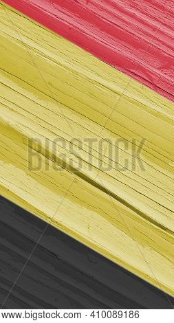 The Flag Of Belgium On Dry Wooden Surface, Cracked With Age. Pale Faded Paint. Vertical Mobile Phone