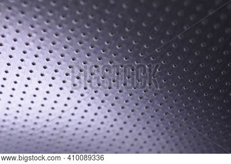 Dark Metal Wallpaper. Tinted Violet Or Purple Background. Perforated Aluminum Surface With Many Hole