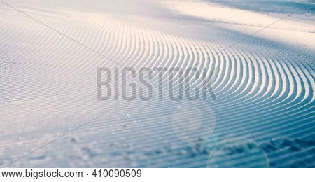 Close Up Of Groomed Tracks On A Slope In A Downhill Ski Resort.
