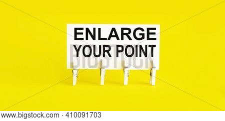 White Paper On Yellow Background With Text Enlarge Your Point