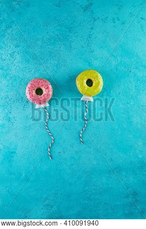 Multicolored Donuts With Glaze And Sprinkles In The Form Of Balloons Flying In The Sky