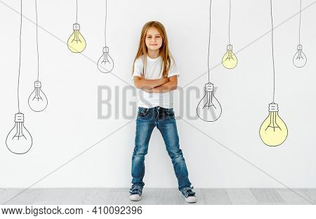 Concept of creativity child mind and ideas. Beautiful blond girl thinking isolated on painted background with lamps.