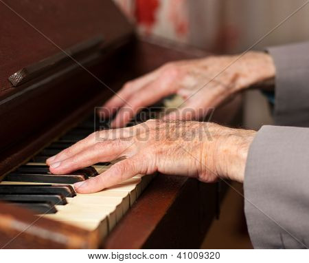 Hands Playing A Harmonium