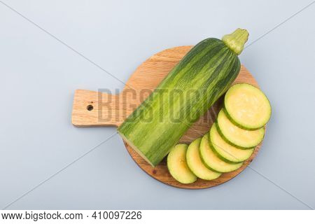 Courgette Or Zucchini On Wooden Cutting Board.