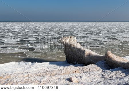 This Is The Frozen Coast Of Azov With An Icy Surf Line And Icy Sludge Near The Coast.