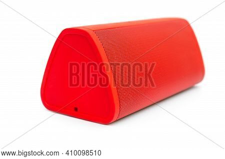 Red Small Bluetooth Audio Speaker On White.