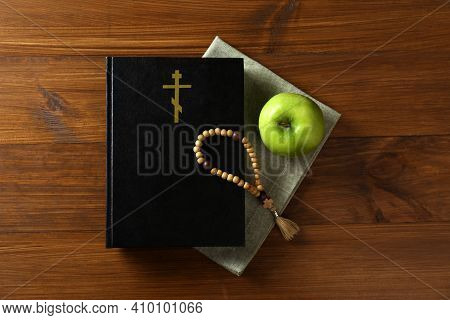 Bible, Rosary Beads And Apple On Wooden Table, Flat Lay. Lent Season