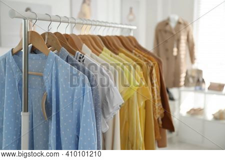 Collection Of Stylish Women's Clothes In Modern Boutique