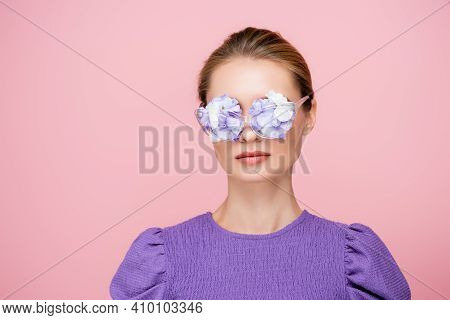 Woman In Purple Blouse, With Flowers In Eyeglasses Isolated On Pink