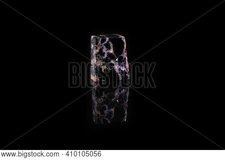 Natural Mineral Stone - Polished Charoite Gemstone On Black Glass Background.