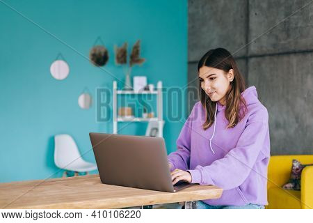 Young Woman College Student Studying With Laptop, Distantly Preparing For Test Exam, Writing Essay D
