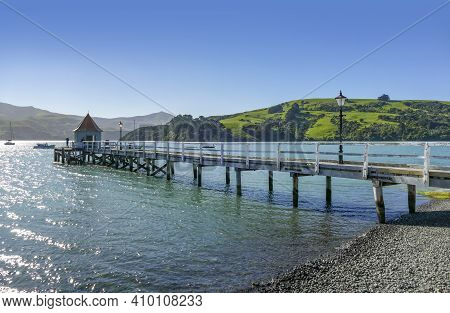 Idyllic Landscape With Wooden Pier Around Akaroa, A Small Town In The Canterbury Region Of The South