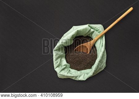 Cabbage Seeds In A Bag And With A Wooden Spoon. Collection, Storage And Preparation Of Seeds For Pla