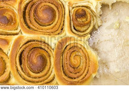 Homemade Fresh Cinnamon Buns Buns Are In A Baking Dish. Several Pieces Are Already Gray.
