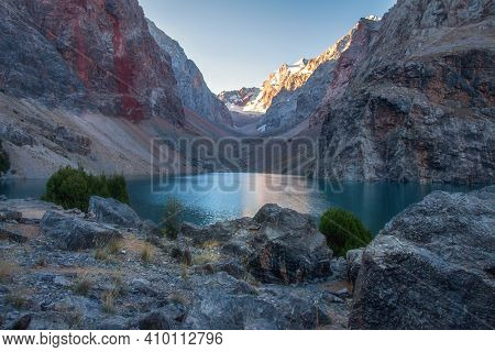 Mountain Landscape With Lake In The Early Morning. Tajikistan Fann Mountains. View On Greater Allo L