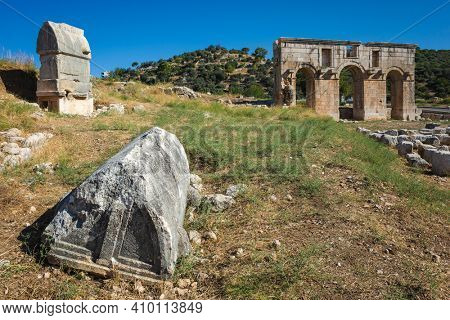 Ruins of rock tombs and city gate of Patara, Arch of Modestus in ancient Lycia on Mediterranean coast, Turkey