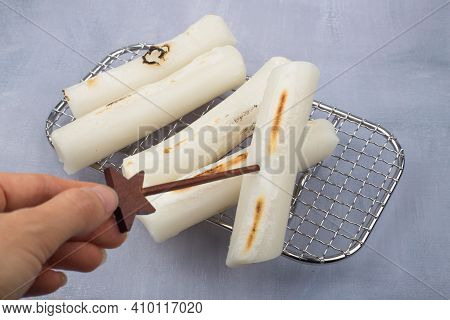 Broiled Bar Rice Cake Korean Food. Stick Of Rounded Rice Cake.