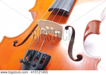Part Of Old Violin On White Background. Cello Close Up Of Scroll And Peg Box. Musical Instrument Of