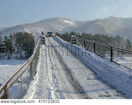 View Of The Aisky Bridge Over The Katun River Against The Background Of The Altai Mountains