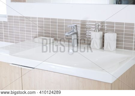 Clean White Bathtub With Stainless Steel Faucet Built Inside Bathroom Of Home
