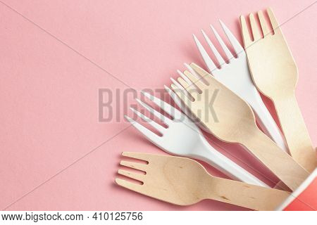 Wooden And Plastic Forks At Paper And Plastic Cup. Eco-friendly And Disposable With Plastic Recyclin