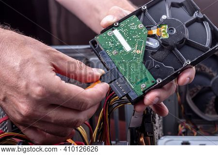 Person Holds Dusty Hdd From Desktop For Cleaning Or Upgrade Old Broken Hardware. Hard Drive Sata And