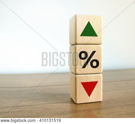 Interest Rates Symbol. Wooden Cubes With The Direction Of An Arrow Symbolizing That The Interest Rat